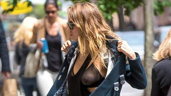 Photo©2012: Abaca Usa/The Grosby GroupNew York, May 06, 2013Jessica Alba went on a stroll to a park to spend some quality time with her daughters in Soho, before the Met Gala. On the way while trying to make a quick change of her jacket, she had a wardrobe malfunction that left her very exposed.ASA
